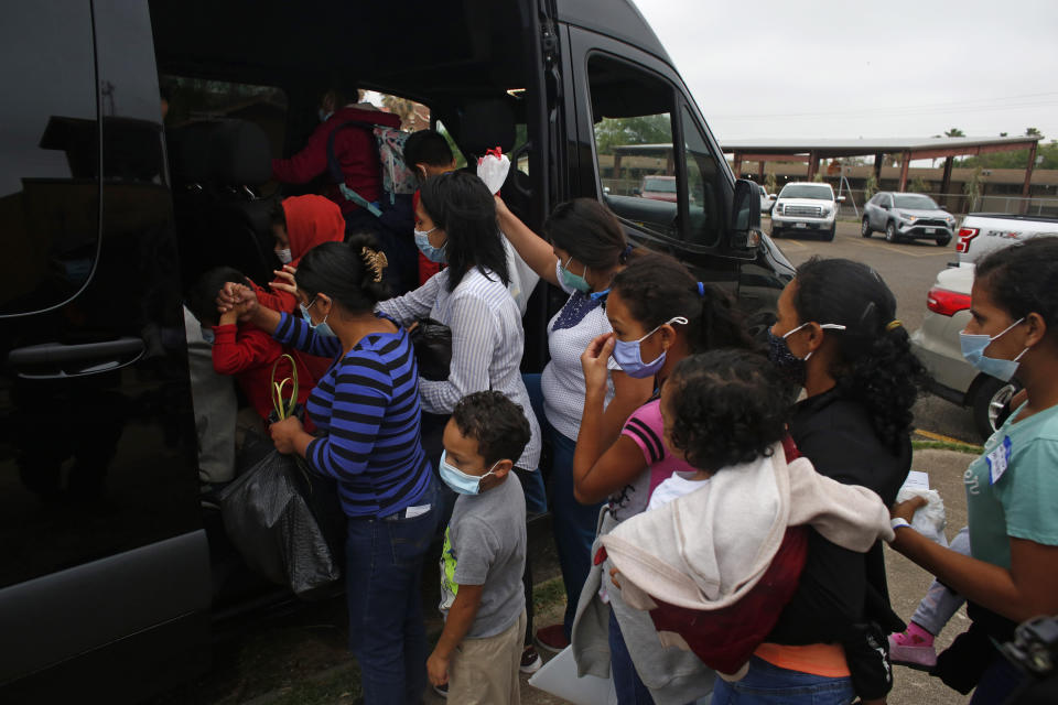 CORRECTS CITY TO MISSION FROM MCALLEN - Migrants board a van at Our Lady of Guadalupe Catholic Church in Mission, Texas, on Palm Sunday, March 28, 2021. U.S. authorities are releasing migrant families at the border without notices to appear in immigration court and sometimes, without any paperwork at all. (AP Photo/Dario Lopez-Mills)