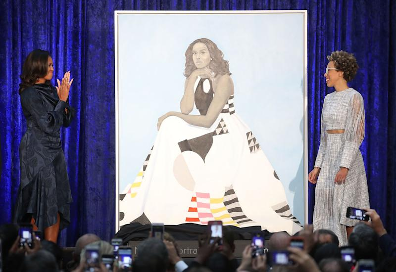 Former U.S. first lady Michelle Obama and artist Amy Sherald unveil Obama's portrait during a ceremony at the Smithsonian's National Portrait Gallery on Feb. 12, 2018.