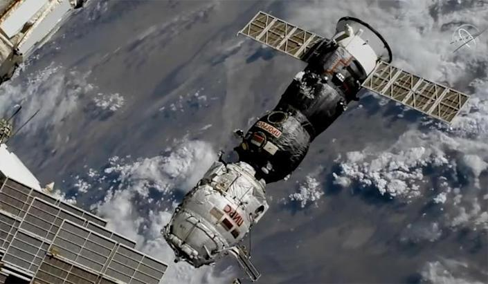 The Progress MS-16/77S cargo ship backs away from the International Space Station early on July 26, 2021, pulling the Pirs airlock and docking compartment, covered in white insulation blankets, away from the Zvezda service module. Pirs' departure clears the way for the arrival of a new Russian multipurpose laboratory module on July 29, 2021. / Credit: NASA TV