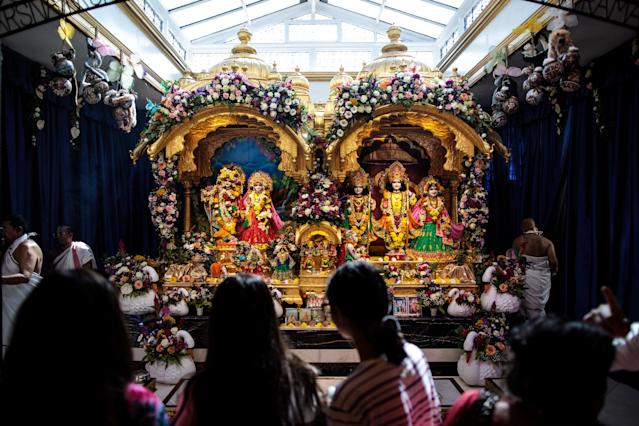 <p>Devotees pray at a shrine during the Janmashtami festival at Bhaktivedanta Manor on September 2, 2018 in Watford, England. (Photo by Jack Taylor/Getty Images) </p>