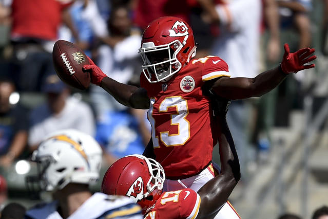 FILE - In this Sept. 9, 2018, file photo, Kansas City Chiefs wide receiver De'Anthony Thomas (13) celebrates after scoring with wide receiver Chris Conley during the second half of an NFL football game against the Los Angeles Chargers in Carson, Calif. The new faces that are on the Kansas City Chiefs roster aren't exactly new. That would be offensive lineman Jeff Allen, who has been with the franchise most of his career, and wide receiver De'Anthony Thomas, who is coming off a knee injury. But their past experience in Kansas City means both could be on the field for a preseason game Saturday night, Aug. 24, 2019. (AP Photo/Kelvin Kuo, File)