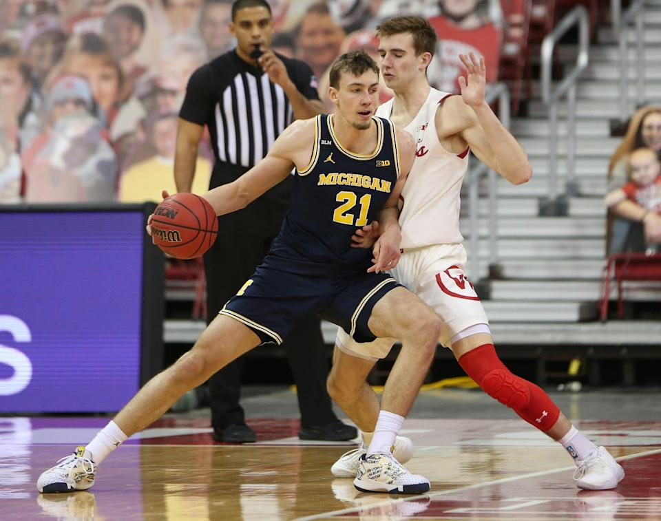 Michigan guard Franz Wagner (21) dribbles the ball against Wisconsin forward Tyler Wahl during the first half at the Kohl Center.