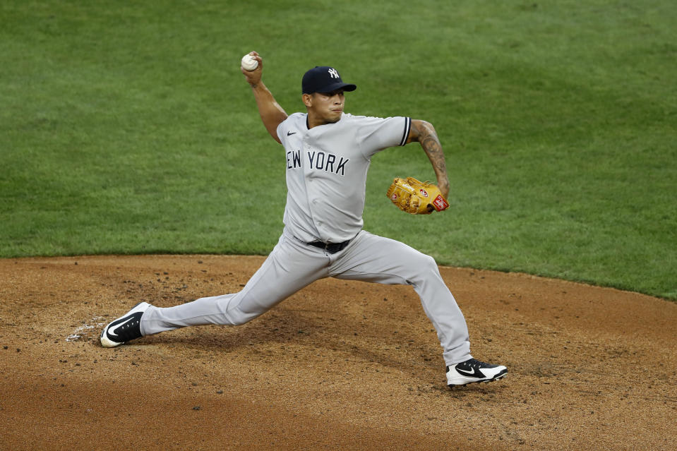 New York Yankees' Jonathan Loaisiga pitches during the first inning of the second baseball game in a doubleheader against the Philadelphia Phillies, Wednesday, Aug. 5, 2020, in Philadelphia. (AP Photo/Matt Slocum)