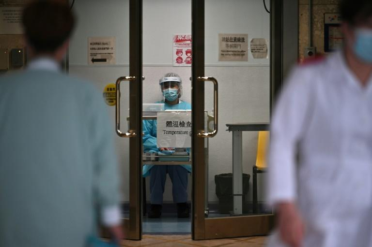 Everyone who tests positive for the virus is admitted to hospital in Hong Kong (AFP Photo/Anthony WALLACE)