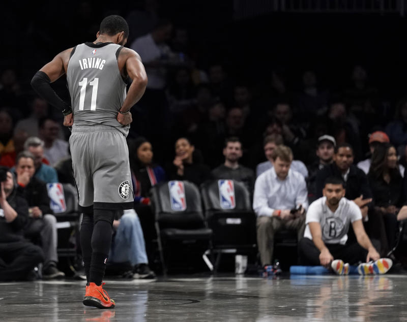 Kyrie Irving's season-ending surgery is a reminder of Brooklyn's brief championship window. (Paul Bereswill/Getty Images)