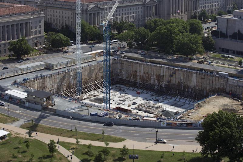 This photo taken June 2, 2013 shows the under-construction Smithsonian National Museum of African American History and Culture in Washington, Oprah Winfrey is giving $12 million to a museum being built on the National Mall that will document African-American life. The National Museum of African American History and Culture said the museum's 350-seat theater will be named after Winfrey. When it's finished in 2015, the museum will house artifacts including Harriet Tubman's shawl, Emmett Till's casket and a Jim Crow-era segregated railroad car. (AP Photo/Alex Brandon)