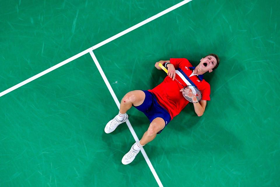 <p>Viktor Axelsen of Denmark falls to the ground after winning the men's singles gold medal badminton match between Chen Long of China and Viktor Axelsen of Denmark on August 2.</p>