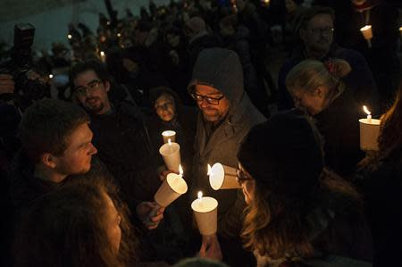 Mourners participate in a candle light vigil for late actor Phillip Seymour Hoffman in the Manhattan borough of New York, February 5, 2014. REUTERS/Keith Bedford