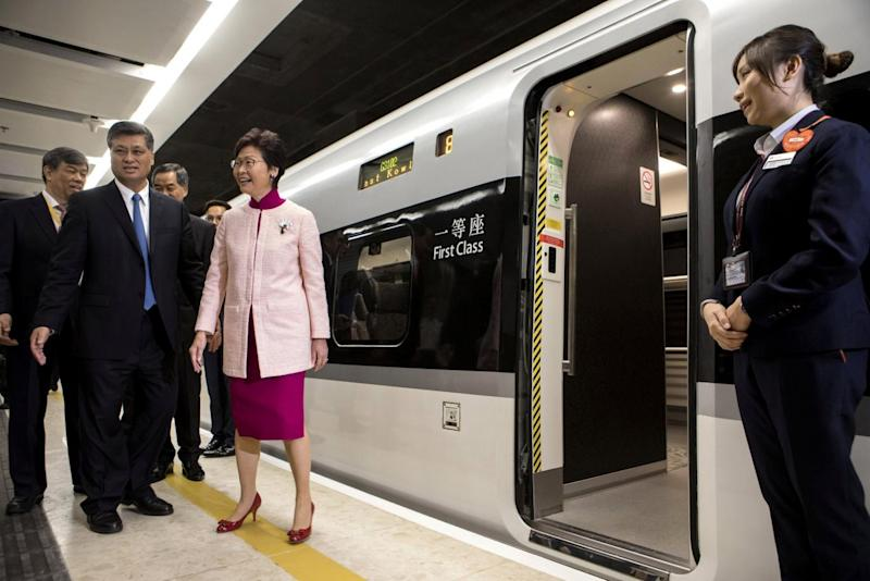 Ma Xingrui, governor of Guangdong Province, and Carrie Lam, Hong Kong's chief executive, stand next to one of the new trains (REUTERS)