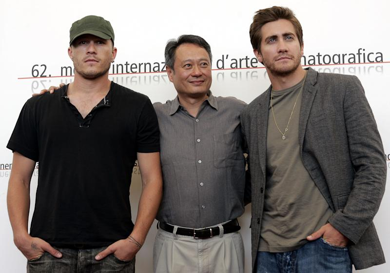 "Chinese movie director Ang Lee, center,is flanked by Australian actor Heath Ledger, left, and US actor Jake Gyllenhaal during a photocall after a press conference to present their latest movie ""Brokeback Mountain"" at the 62nd edition of the Venice Film Festival in Venice's Lido, northern Italy, Friday, Sept. 2, 2005. (AP Photo/Domenico Stinellis)"