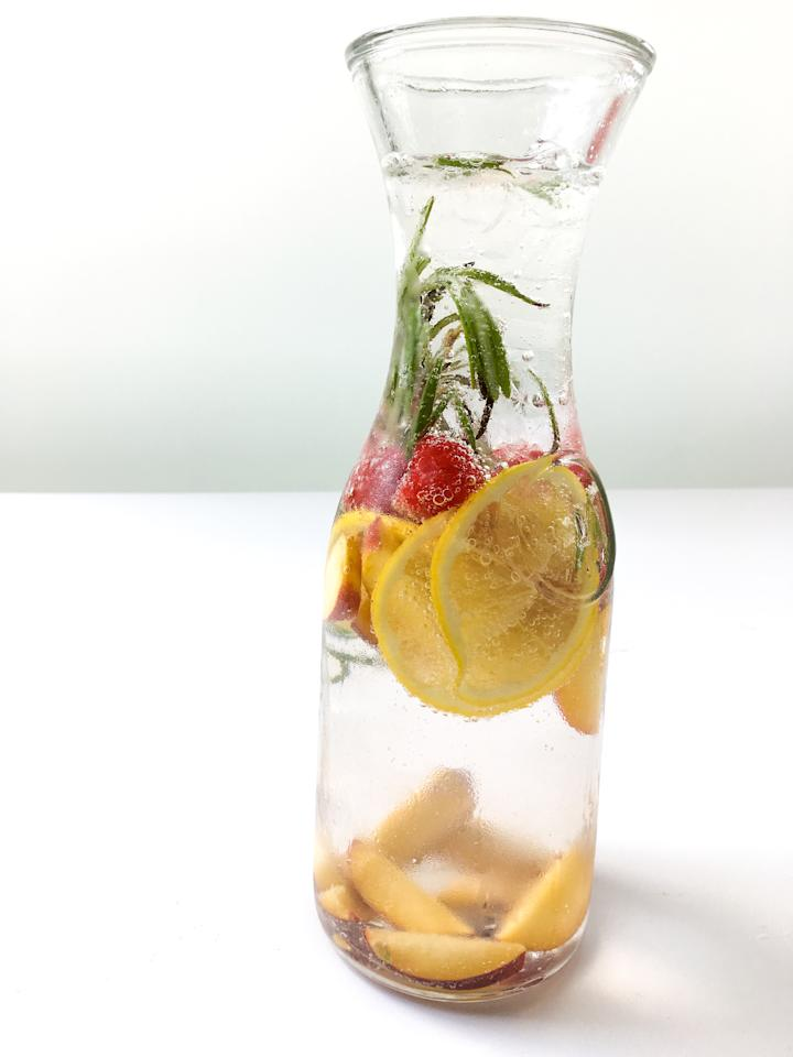 <p>This refreshing drink's summery flavors will have you reaching for it all day. Stay hydrated while celebrating in-season summer produce with sliced peaches, lemon wedges, and red raspberries. The rosemary adds an earthy, green kick to everyday H2O.<br /><strong>Make This Water:</strong><br />2 sliced small peaches (or 1 large depending on the size)<br />1/2 lemon sliced<br />1/2 cup of muddled raspberries<br />2 sprigs of rosemary </p>