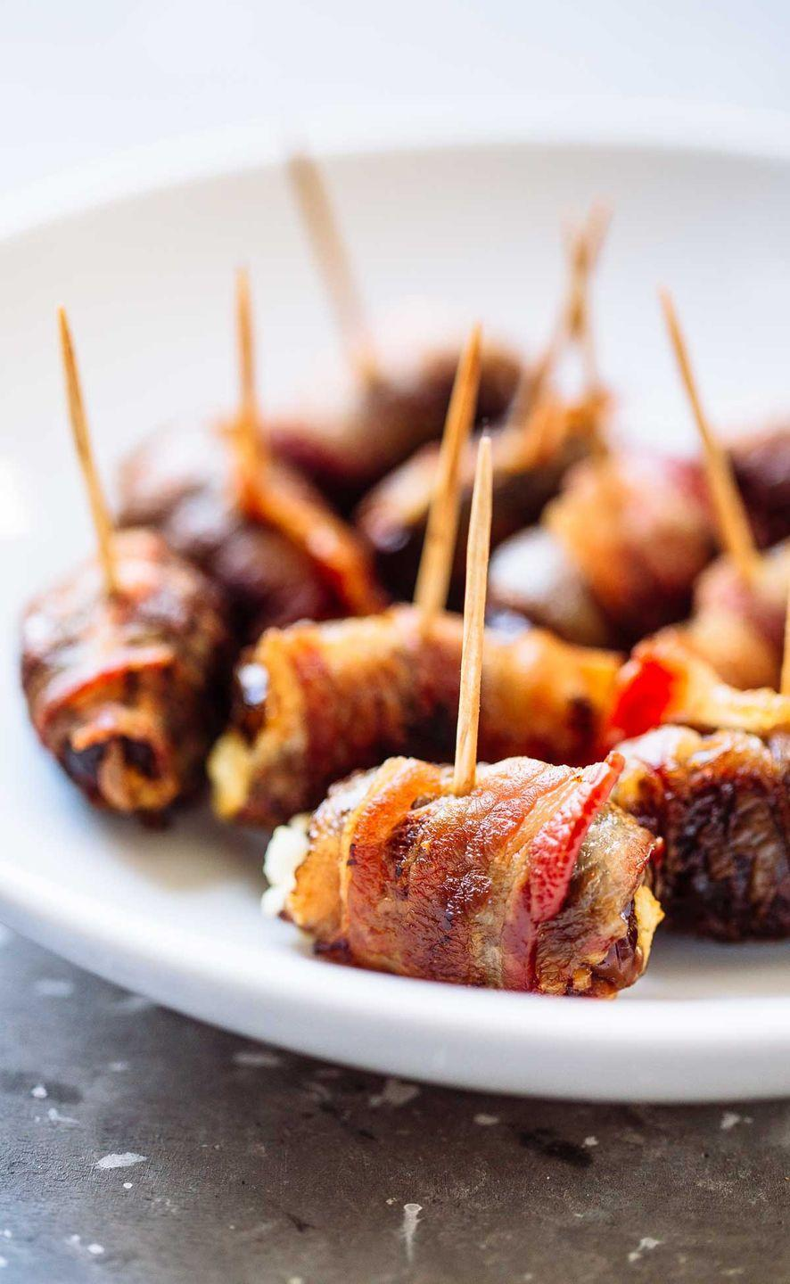 "<p>Want to take something from dull to AMAZE? Wrap it in bacon.</p><p>Get the recipe from <a href=""http://pinchofyum.com/bacon-wrapped-dates-with-goat-cheese"" rel=""nofollow noopener"" target=""_blank"" data-ylk=""slk:Pinch of Yum"" class=""link rapid-noclick-resp"">Pinch of Yum</a>.</p>"