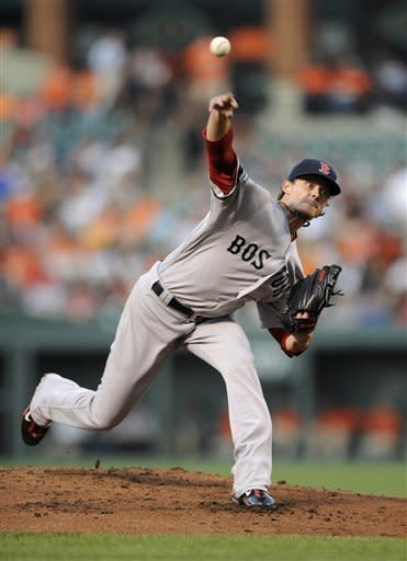 Boston Red Sox starting pitcher Clay Buchholz delivers against the Baltimore Orioles during the first inning of a baseball game on Thursday, Aug. 16, 2012, in Baltimore. (AP Photo/Nick Wass)
