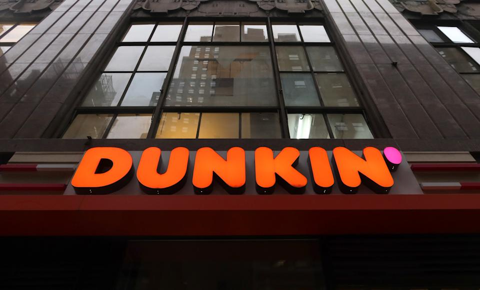 NEW YORK, NY - DECEMBER 16: The corporate logo for Dunkin', replacing the former name of Dunkin Donuts sits above the entrance to a store on 38th Street on December 16, 2019, in New York City. (Photo by Gary Hershorn/Getty Images)