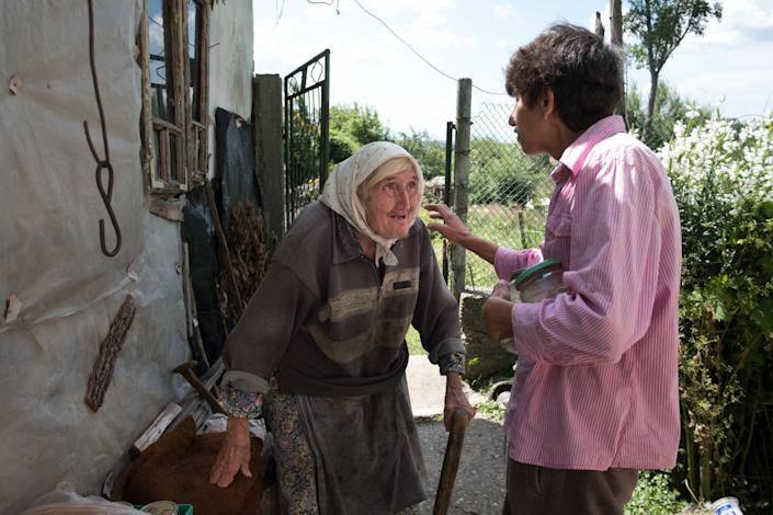 "Dimitrina Kolikova delivers food to elderly and invalid residents, including 80-year-old Ivanka Georgova, in rural Bulgaria. <span class=""copyright"">(Jodi Hilton / For The Times)</span>"