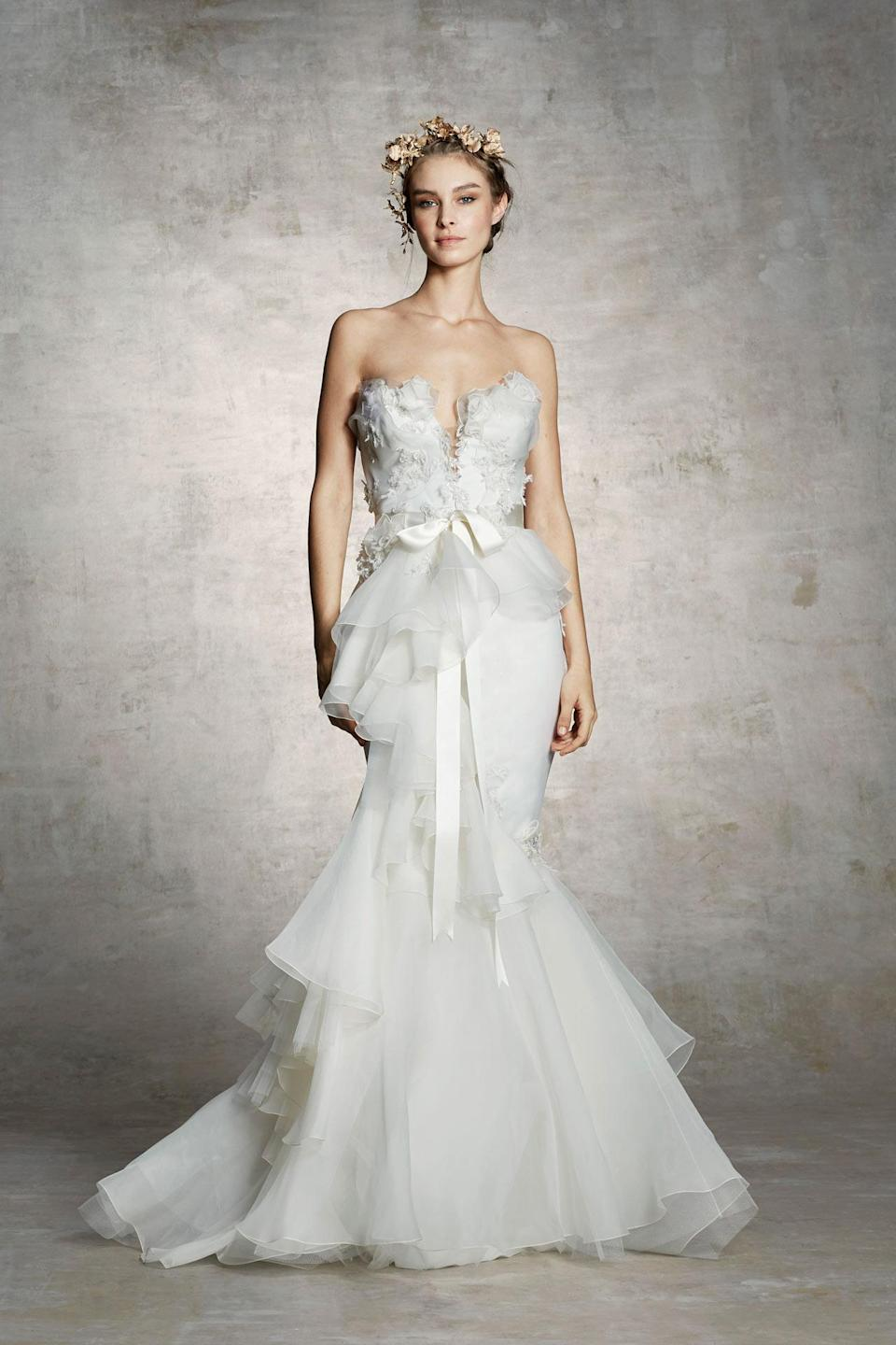 <p>Strapless gown with bow-tie sash and cascading ruffles. (Photo: Courtesy of Marchesa) </p>