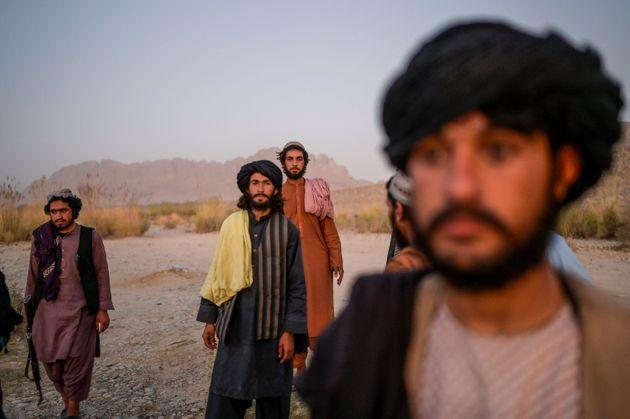 In this picture taken on September 23, 2021, Taliban members enjoy an afternoon on the banks of a river in Kandahar. (Photo by Bulent KILIC / AFP) (Photo by BULENT KILIC/AFP via Getty Images) (Photo: BULENT KILIC via Getty Images)