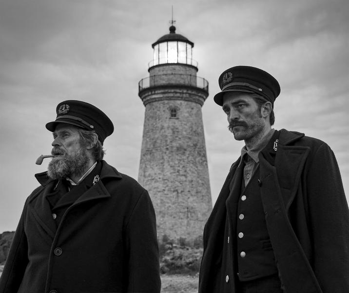 """This image released by A24 Films shows Willem Dafoe, left, and Robert Pattinson in a scene from """"The Lighthouse."""" The Safdie brothers' Diamond District crime film """"Uncut Gems"""" and Robert Eggers' fever-dream period tale """"The Lighthouse"""" lead the 35th annual Film Independent Spirit Awards with five nominations each. The Spirit Awards will be held Feb. 8, the day before the Academy Awards. (Eric Chakeen/A24 Pictures via AP)"""