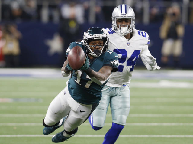 <p>Philadelphia Eagles wide receiver Alshon Jeffery (17) bobbles the ball as he dives past Dallas Cowboys cornerback Chidobe Awuzie (24) for a pass during the second half of an NFL football game in Arlington, Texas, Sunday, Dec. 9, 2018. Jeffery did not make the catch. (AP Photo/Roger Steinman) </p>