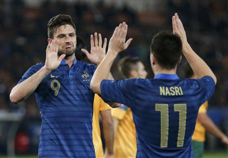 France's Giroud celebrates with team mate France's Nasri after he scored against Australia during their friendly soccer match