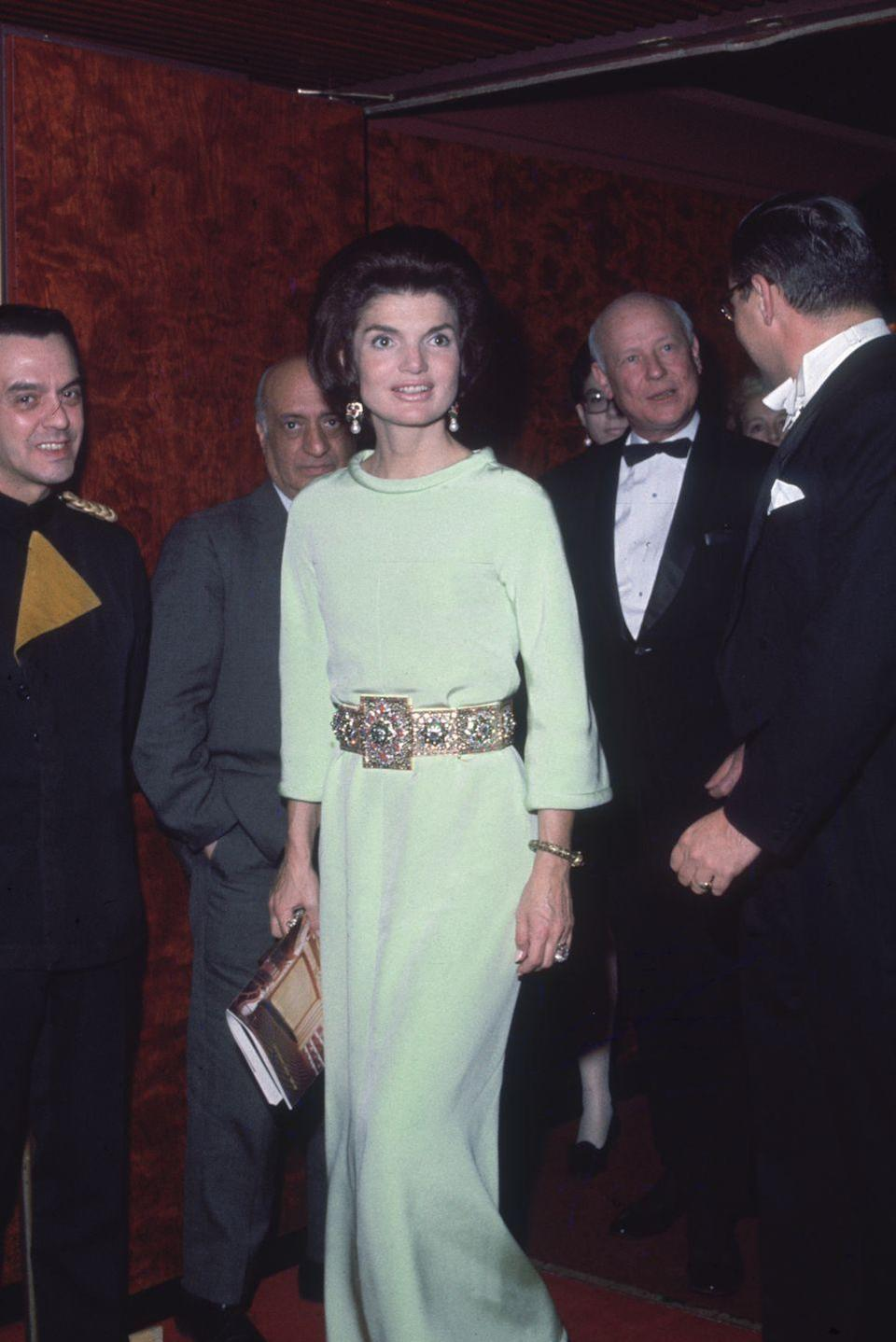 <p>Jackie stylishly dressed in a long-sleeve gown and gold bejeweled belt at the Metropolitan Opera in Lincoln Center. </p>