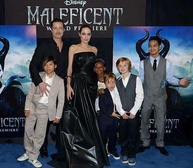 <p><em>Maleficent</em> was a family film, so out came the fam in May 2014. Funny enough, the one missing from the family photo is Vivienne — and she actually appeared in the flick, making her acting debut as the young Aurora. (Photo: Getty Images for Disney) </p>