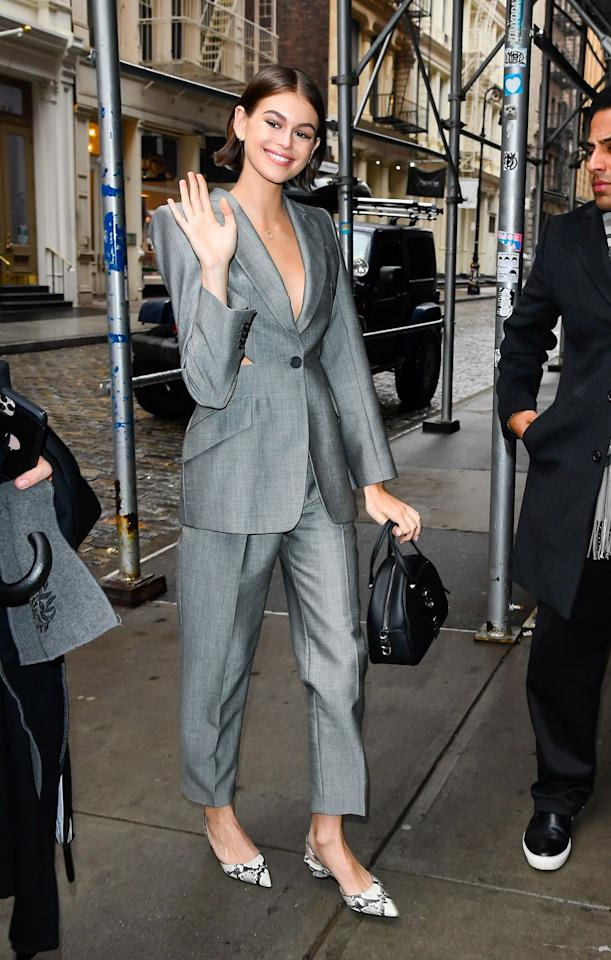 <p><strong>February 2020</strong> Kaia Gerber looked chic in a grey Alexander McQueen trouser suit with cut-out detail.</p>
