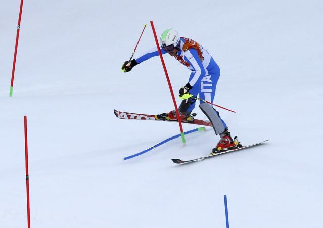 Italy's Peter Fill straddles a gate during the slalom run of the men's alpine skiing super combined event during the 2014 Sochi Winter Olympics at the Rosa Khutor Alpine Center in Rosa Khutor February 14, 2014. REUTERS/Mike Segar (RUSSIA - Tags: OLYMPICS SPORT SKIING)