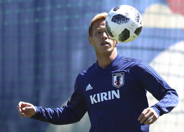Japan's Keisuke Honda warms up during a training session of Japan national soccer team at the 2018 soccer World Cup in Kazan, Russia, Sunday, June 17, 2018. (AP Photo/Eugene Hoshiko)