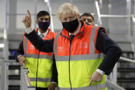 Britain's Prime Minister Boris Johnson, and Chancellor Rishi Sunak during a visit to a tesco.com distribution centre in London, Wednesday, Nov. 11, 2020. (AP Photo/Kirsty Wigglesworth, pool)