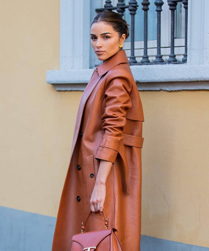 MILAN, ITALY – FEBRUARY 21: Olivia Culpo is seen wearing rust brown coat and pants, sheer top outside Tods during Milan Fashion Week Fall/Winter 2020-2021 on February 21, 2020 in Milan, Italy. (Photo by Christian Vierig/Getty Images)