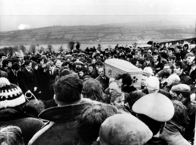 File - Pallbearers carry one of 13 coffins of Bloody Sunday victims to a graveside during a funeral in Derry, Northern Ireland, following requiem mass at nearby St. Mary's church at Creggan Hill on in this b/w Feb. 2, 1972 file photo. Chief Constable Matt Baggott told Northern Ireland's policing board Thursday July 5 2012 that his force is planning a Bloody Sunday investigation that would require 30 detectives and take four years. Northern Ireland's police commander says his detectives will eventually investigate the Bloody Sunday massacre to determine whether any British soldiers should be charged with murder _ but not yet. Families of the 13 people killed when troops opened fire on Irish Catholic demonstrators in 1972 have waited for a criminal investigation to start since 2010, when the biggest fact-finding probe in British history determined that the soldiers targeted unarmed civilians. (AP Photo/ File)