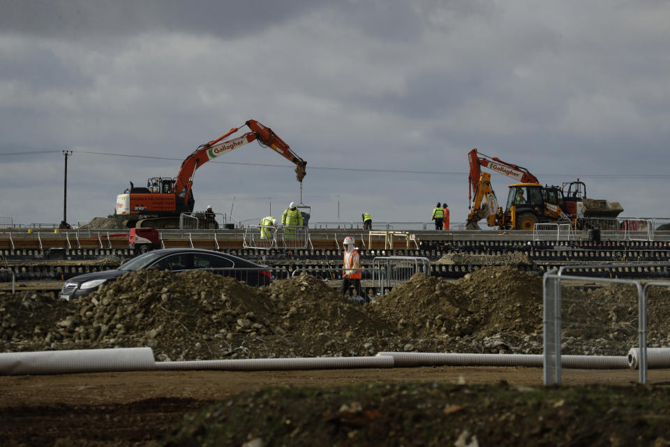Construction takes place on a post-Brexit customs clearance border post facility on land that was previously a field between the villages of Mersham and Sevington in the county of Kent, south east England, Tuesday, Oct. 6, 2020. (AP Photo/Matt Dunham)