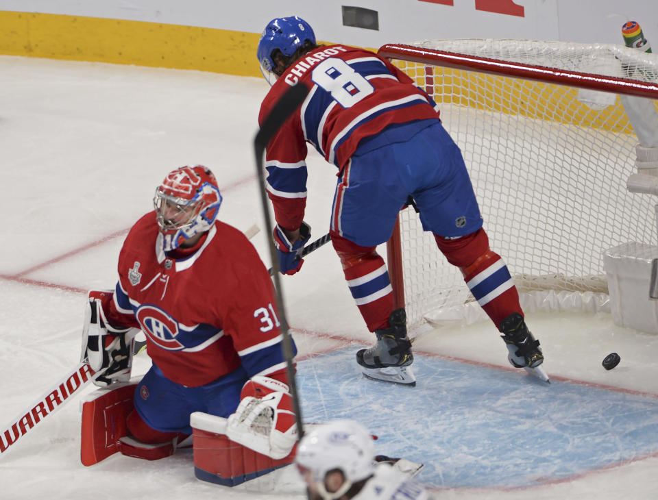 Montreal Canadiens goaltender Carey Price (31) and teammate Ben Chiarot react after the second Tampa Bay Lightning goal during the first period of Game 3 of the NHL hockey Stanley Cup Final, Friday, July 2, 2021, in Montreal. (Ryan Remiorz/The Canadian Press via AP)