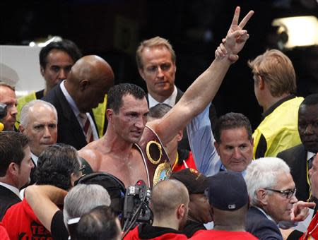 World heavyweight world champion Klitschko of Ukraine celebrates his victory over Povetkin of Russia after their heavyweight title fight in Moscow