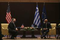 U.S. Secretary of State Mike Pompeo, left, and Greek Foreign Minister Nikos Dendias speak during their meeting in the northern city of Thessaloniki, Greece, Monday, Sept. 28, 2020. Pompeo and Dendias, will sign a bilateral science and technology agreement, as well as host energy sector business leaders for a discussion to highlight energy diversification and infrastructure projects in Greece. (AP Photo/Giannis Papanikos, Pool)