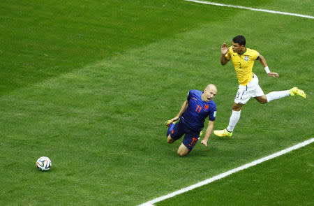 Arjen Robben of the Netherlands falls after having his shirt pulled by Brazil's Thiago Silva in the penalty box during their 2014 World Cup third-place playoff at the Brasilia national stadium in Brasilia July 12, 2014. REUTERS/Ruben Sprich