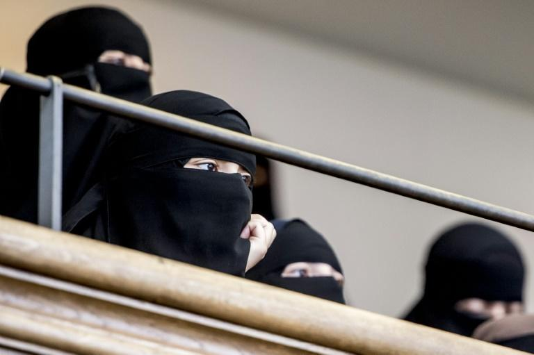 Activists wearing burqas march through Copenhagen to protest face veil ban