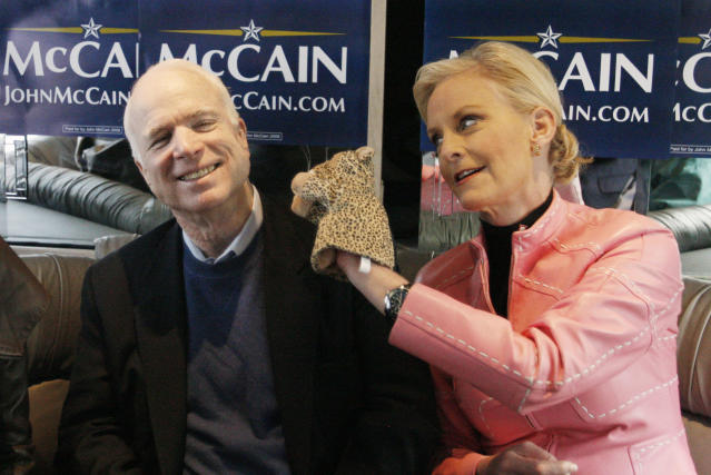 """<p>Cindy McCain, right, wife of Republican presidential hopeful Sen. John McCain share a light moment with a cheetah hand puppet as they ride the """"Straight Talk Express"""" campaign bus to a polling station on the day of South Carolina's Republican presidential primary in Charleston, S.C., during the 2008 campaign. (Photo: Charles Dharapak/AP) </p>"""