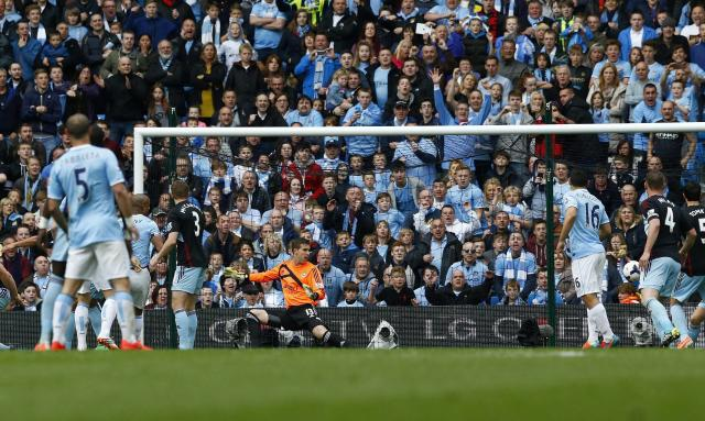 """Manchester City's captain Vincent Kompany (3rd L) shoots and scores against West Ham United during their English Premier League soccer match at the Etihad Stadium in Manchester, northern England May 11, 2014. REUTERS/Darren Staples (BRITAIN - Tags: SPORT SOCCER) FOR EDITORIAL USE ONLY. NOT FOR SALE FOR MARKETING OR ADVERTISING CAMPAIGNS. NO USE WITH UNAUTHORIZED AUDIO, VIDEO, DATA, FIXTURE LISTS, CLUB/LEAGUE LOGOS OR """"LIVE"""" SERVICES. ONLINE IN-MATCH USE LIMITED TO 45 IMAGES, NO VIDEO EMULATION. NO USE IN BETTING, GAMES OR SINGLE CLUB/LEAGUE/PLAYER PUBLICATIONS"""