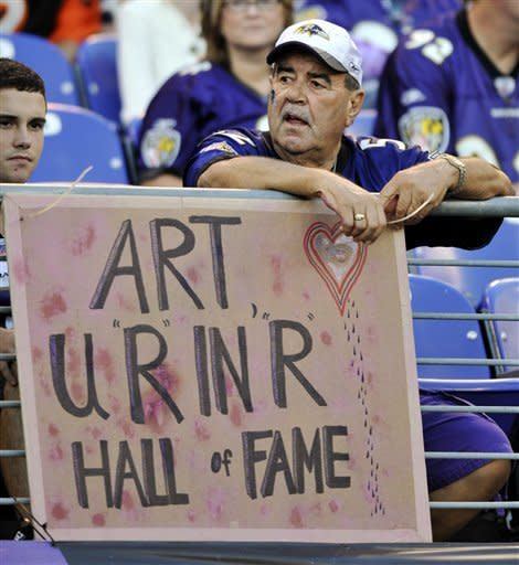 A Baltimore Ravens fan displays a sign honoring former Ravens owner Art Modell before an NFL football game between the Ravens and the Cincinnati Bengals in Baltimore, Monday, Sept. 10, 2012. Modell died on Sept. 6. (AP Photo/Gail Burton)