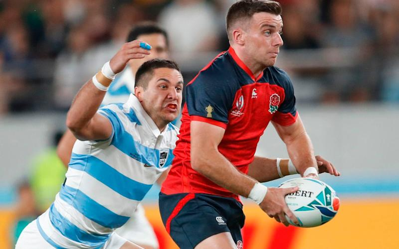 England fly-half George Ford (right) runs with the ball against Argentina - AFP