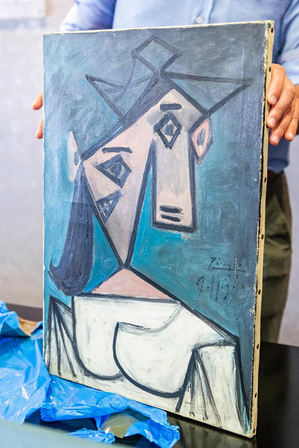 This handout photograph taken and released by the Greek Police on June 29, 2021 shows a recovered painting of Picasso titled