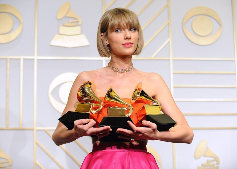 Taylor Swift poses in the press room at the The 58th Grammy Awards on Feb. 15 in Los Angeles.