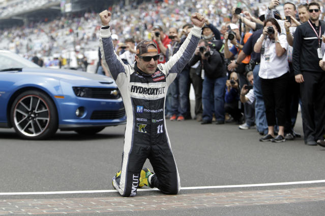 FILE - In this May 26, 2013, file photo, Tony Kanaan, of Brazil, celebrates on the start/finish line after winning the Indianapolis 500 auto race at the Indianapolis Motor Speedway in Indianapolis, Kanaan will get to race 5 oval events, including the Indianapolis 500, in what will be called his farewell tour this upcoming IndyCar season. (AP Photo/Tom Strattman, File)