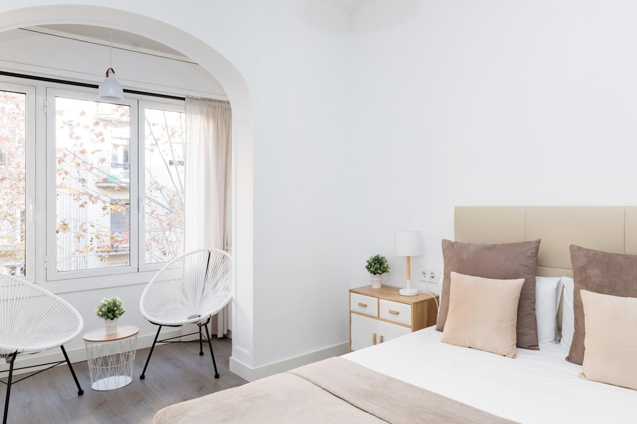 """<p>This Airbnb Plus two blocks from <a href=""""https://www.cntraveler.com/story/how-to-skip-the-line-at-sagrada-familia?mbid=synd_yahoo_rss"""" target=""""_blank"""">La Sagrada Familia</a> offers four beds spread across three rooms (two queens and two singles), perfect for a large group heading to the city. (Bonus, two bathrooms!) Filled with light pinks and neutral tones, the home is beautifully decorated and offers a full living room and kitchen for everyone to congregate in. Note to <a href=""""https://www.cntraveler.com/story/our-favorite-packing-cubes?mbid=synd_yahoo_rss"""" target=""""_blank"""">overpackers</a> and those with accessibility concerns: The apartment is on the second floor and there isn't an elevator.</p> <p><strong>Book Now:</strong> <a href=""""http://airbnb.pvxt.net/WEkVM"""" rel=""""nofollow"""" target=""""_blank"""">From $195 per night, airbnb.com</a></p>"""