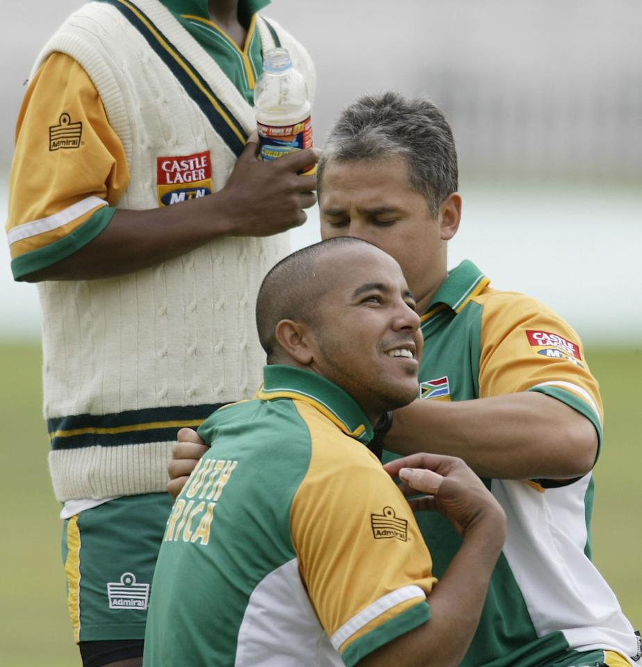 LONDON - SEPTEMBER 2:  Paul Adams of South Africa gets treatment on his shoulder after he was hit by the ball during South Africa training for the forthcoming 5th npower Test match between England and South Africa at The AMP Oval  on September 2, 2003 in London, England. (Photo By Clive Mason/Getty Images)