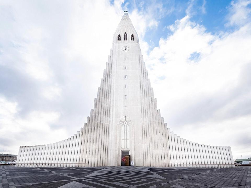"""Designed to resemble the basalt lava that flows in <a href=""""https://www.cntraveler.com/galleries/2016-04-27/the-10-most-beautiful-places-in-iceland?mbid=synd_yahoo_rss"""" rel=""""nofollow noopener"""" target=""""_blank"""" data-ylk=""""slk:Iceland"""" class=""""link rapid-noclick-resp"""">Iceland</a>, the church looks like a strong upside-down V made of tall, thin white beams. Even though the exterior is striking, make sure you visit the inside as well—there's a sculpture of the famous explorer Leif Eriksson and an observatory at the top where you can get breathtaking views of <a href=""""https://www.cntraveler.com/story/best-things-to-do-in-iceland?mbid=synd_yahoo_rss"""" rel=""""nofollow noopener"""" target=""""_blank"""" data-ylk=""""slk:Reykjavik"""" class=""""link rapid-noclick-resp"""">Reykjavik</a>."""