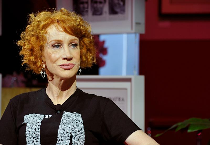 Kathy Griffin looks to the right of the camera wearing a black T-shirt