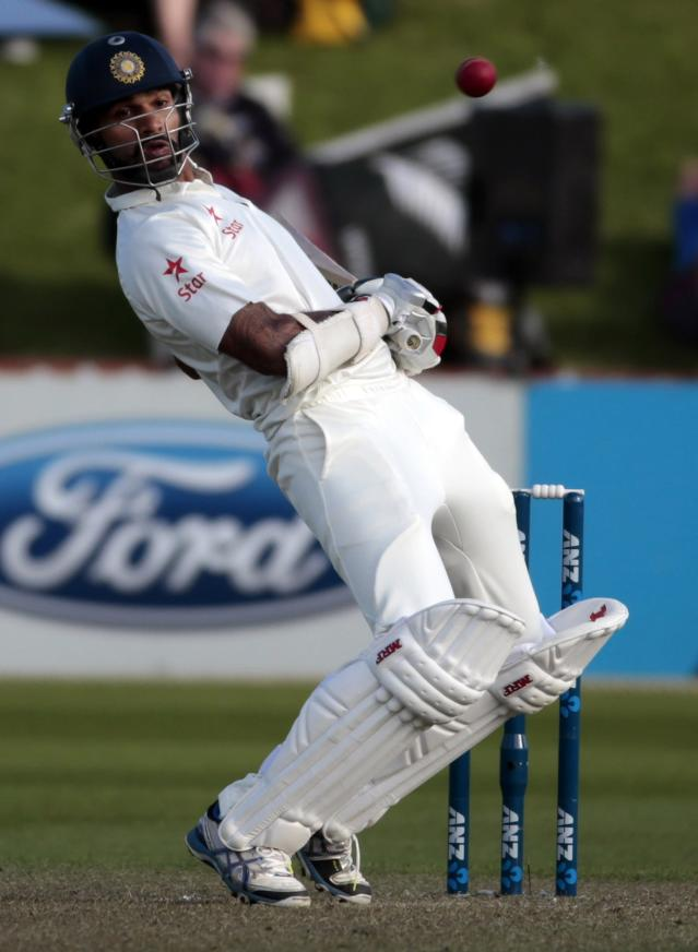 India's Shikhar Dhawan avoids a bouncer against New Zealand during the first innings on day one of the second international test cricket match at the Basin Reserve in Wellington, February 14, 2014. REUTERS/Anthony Phelps (NEW ZEALAND - Tags: SPORT CRICKET)